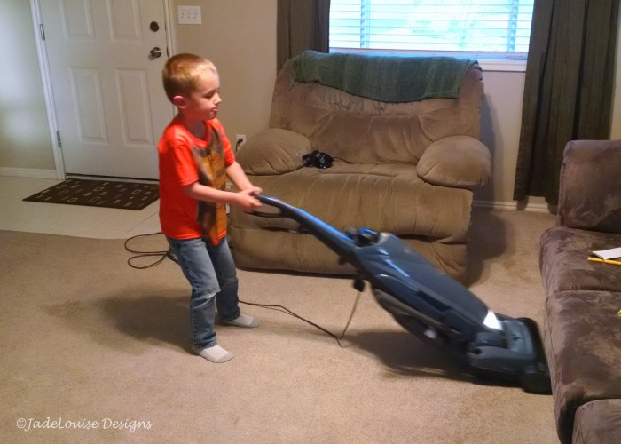 Vacuuming boy