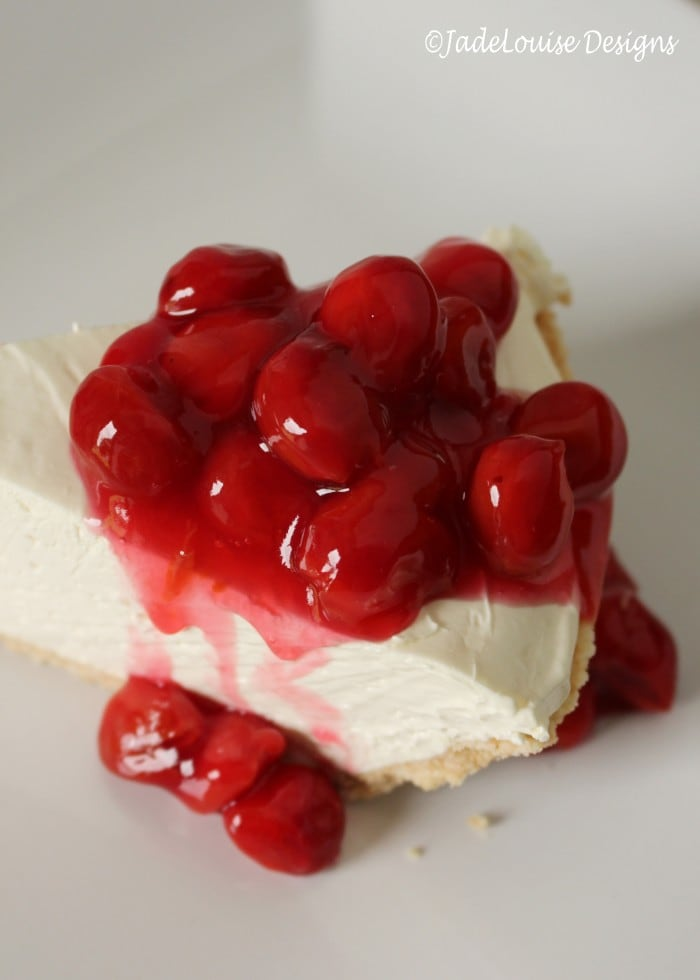 Sour cherry sauce on top of the perfect no bake cheesecake