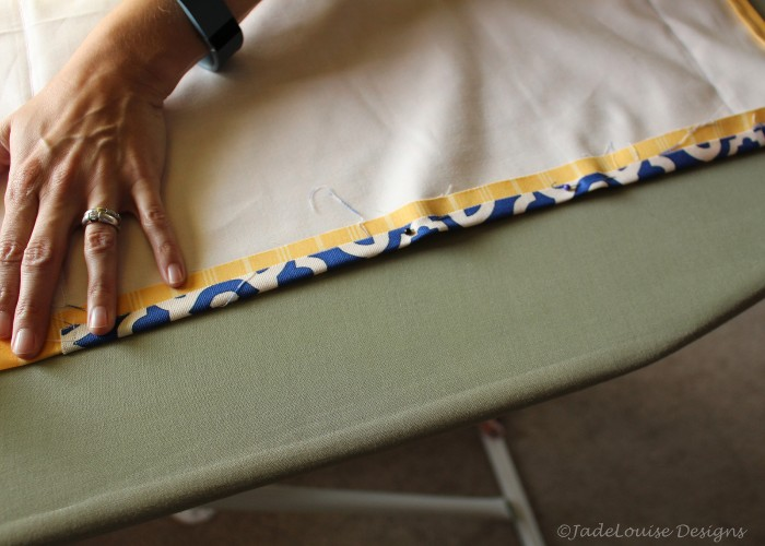 Fold, iron and pin the bottom hem