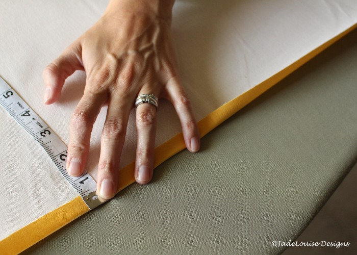 Measure and fold background fabric, then iron