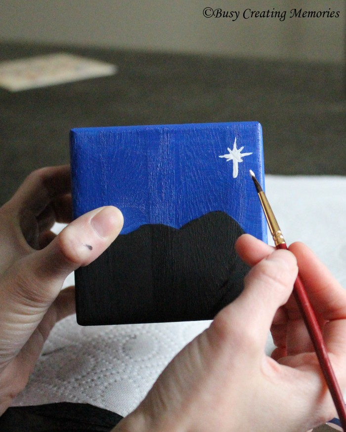 Use the small brush to paint the star