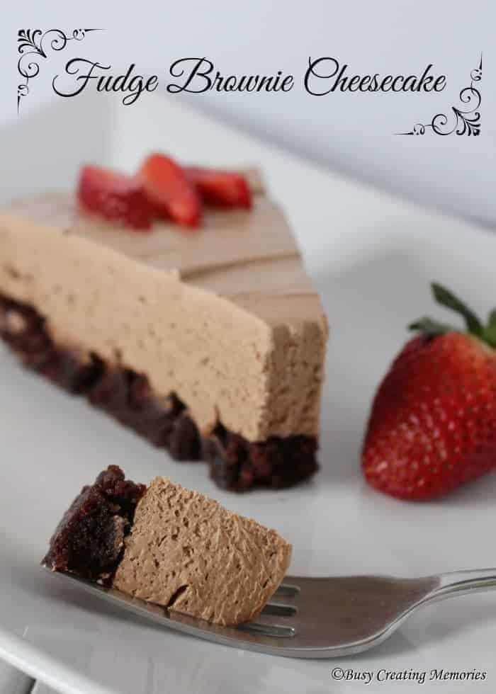 Delicious Fudge Brownie Cheesecake topped with ripe strawberries
