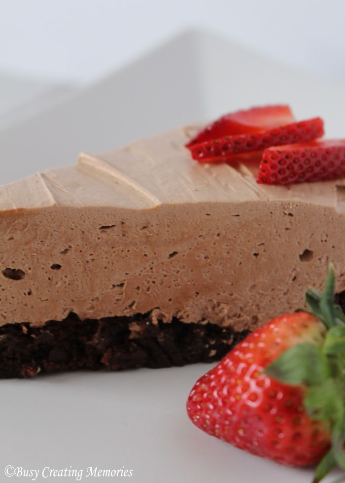Strawberries are the perfect finishing touch for this fudgy cheesecake