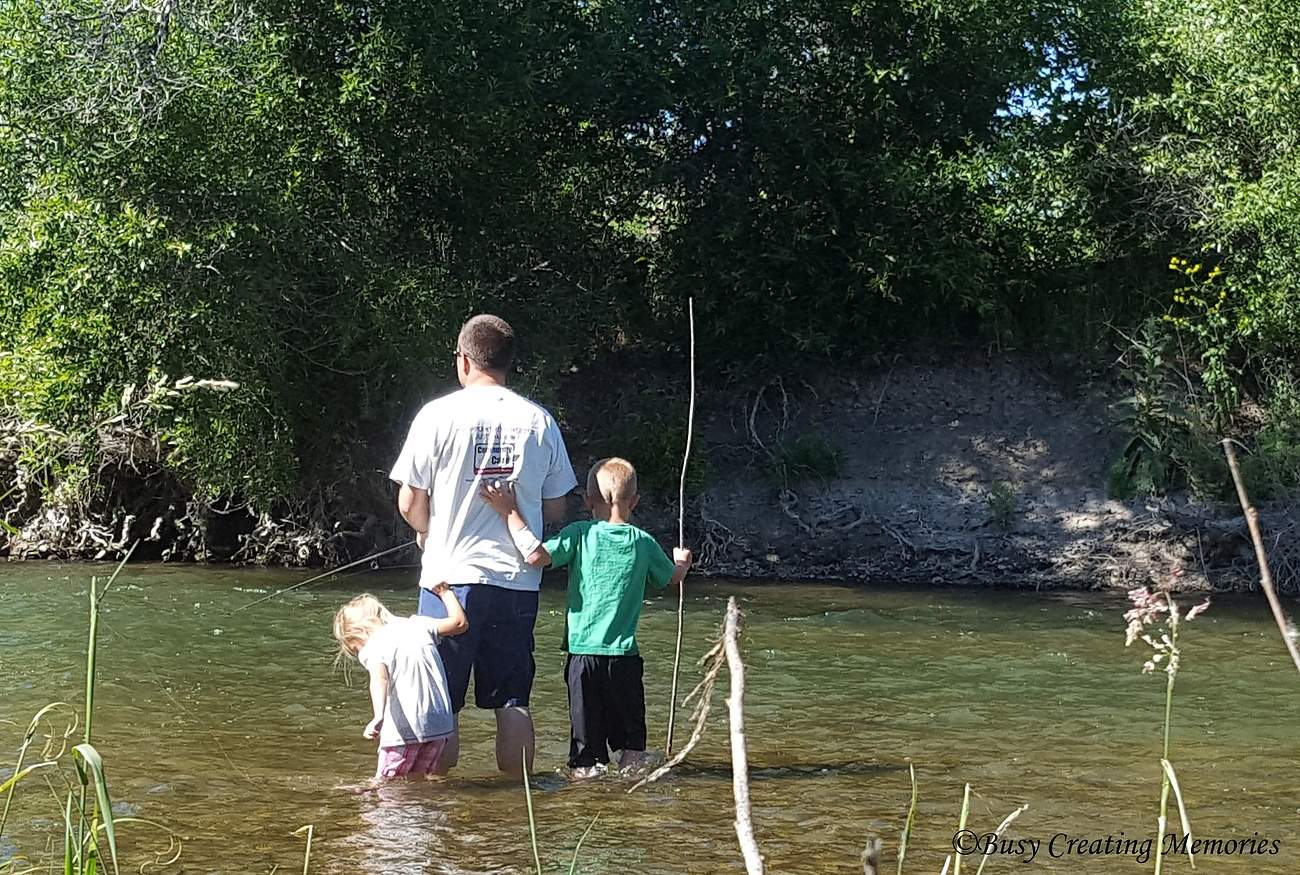 hanging on to dad so we don't fall in the river