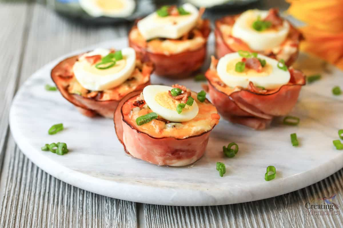 marble plate filled with 5 Easy Ham, Egg & Cheese Keto Breakfast Muffins Cups