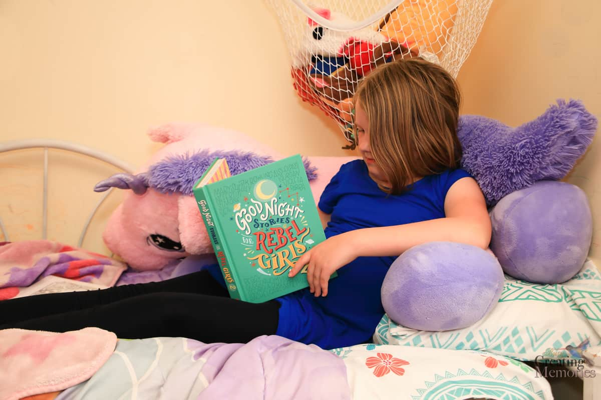 girl reading good night stories for rebel girls