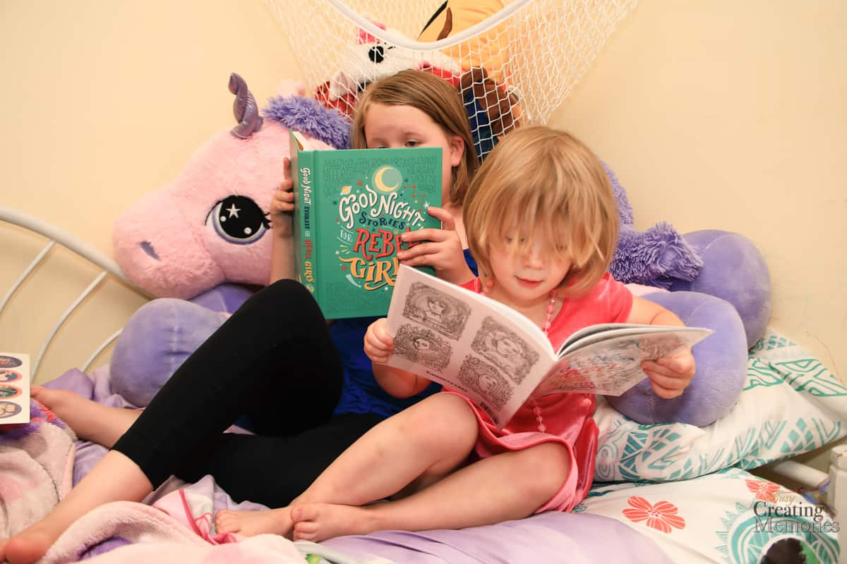 Two girls reading Good night stories for rebel girls