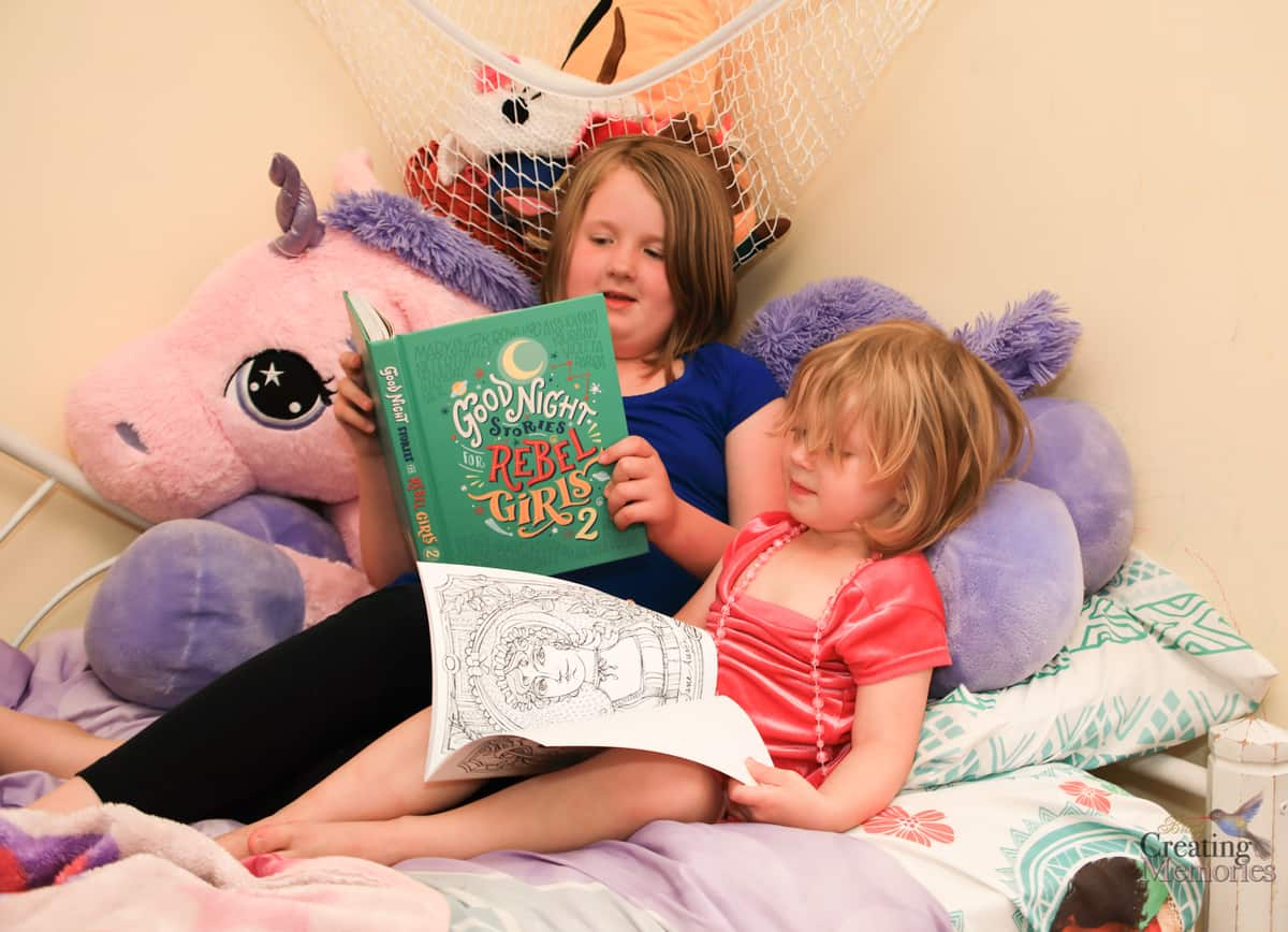 two  young girls reading good night stories for rebel girls