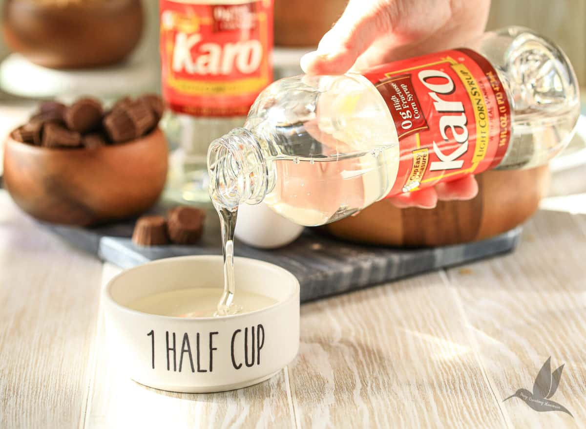 Karo Corn Syrup being poured into a measuring cup for cookie recipe
