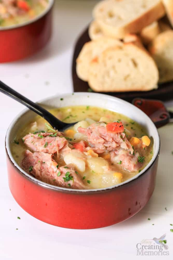 Close up image of ham bone soup with ham shake, russet potatoes and a creamy sauce